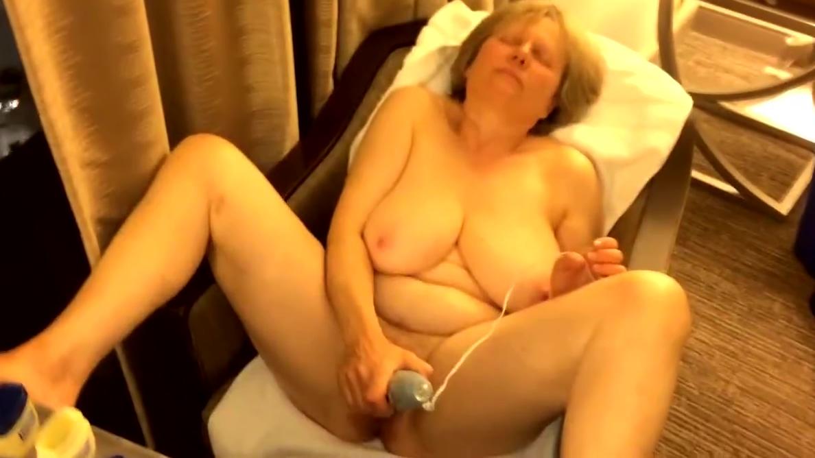 60+ GILF gets off in hotel room window