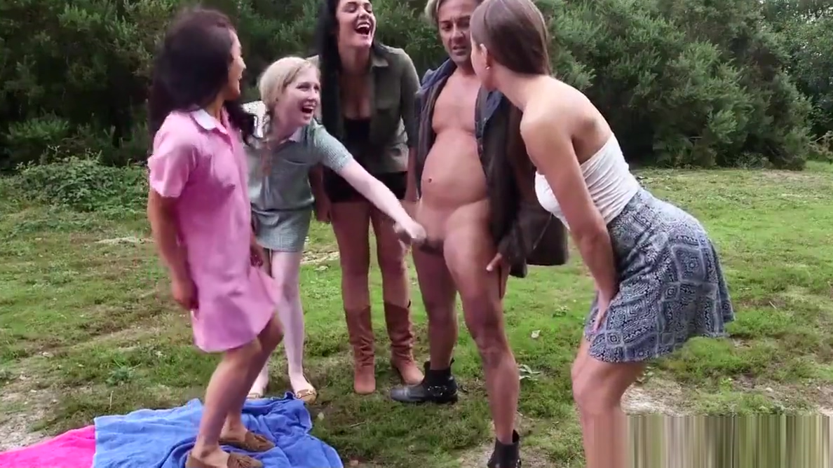 Femdoms jerking cfnm sub outdoors in group