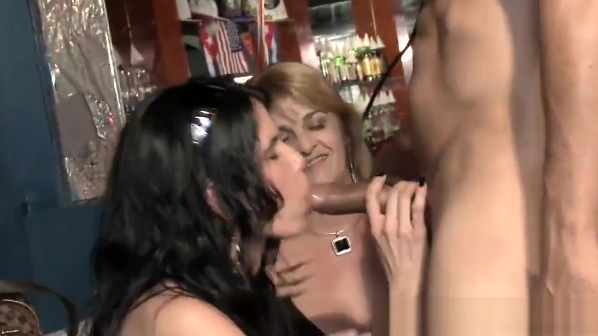 Party babes taking turns in blowing strippers big dick