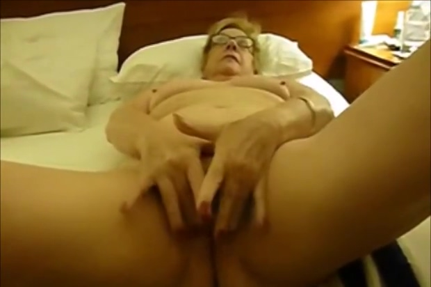 Horny granny fingering pussy. Amateur