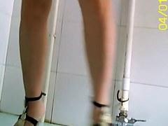 European girl in high heels pissing on the toilet