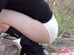 Sharked Japan beauty hides her panty ass in bushes