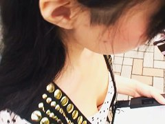 Asian downblouse video features an Asian chick with perky tits.