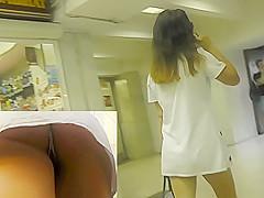 Dark-haired babe caught on the upskirt camera