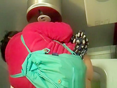 Woman in red jacket pissing