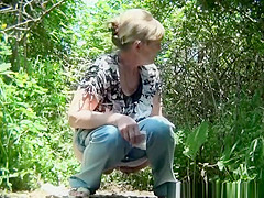 Mature woman caught in the woods pissing