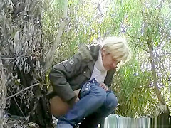Mature caught pissing outdoors next to tree
