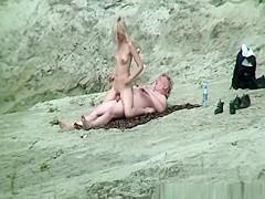 Nude couple fucking in the rocks
