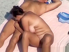 Couple blowjob at beach