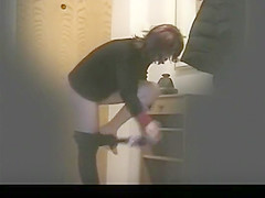 Woman undressing in apartment hall