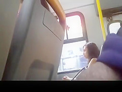 Guy flashes his balls in the bus