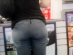Tight jeans woman buying games