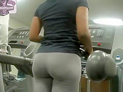 Latina in gym working out