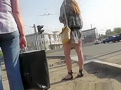Girl in short dress waits for the bus