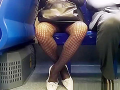 Woman with black fishnets upskirted