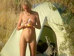 Nudist camper rubs oil all over herself