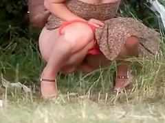 Red panties down to her knees