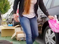 Sweet breasts of a girl bending down