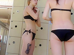 Tattooed girl with friends by the pool