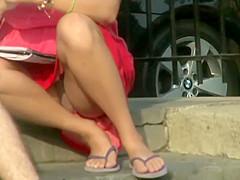 Panties under skirt revealed when she sat