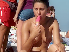Topless chick eats an ice cream