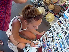 Watch her tits while she buys postcards