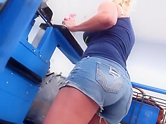Sexy milf paying at the cashier
