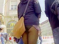 Bizarre accidental upskirt shows ass
