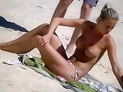 Voyeuring a topless girl's big fake tits