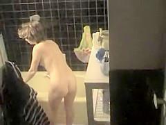 Sexy milf preparing herself a bath-