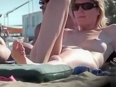 Skinny woman enjoys sunbathing in the nude