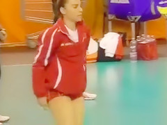 Athletic cutie with a nice butt warms up before the match