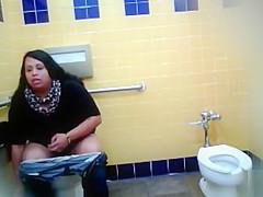 Lovely Brazilian fattie gets recorded urinating hard in a public restroom
