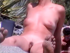 Lots of lovely asses in voyeur beach compilation video