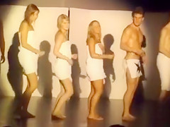Australian students dance around wrapped in towels