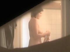 Busty aunt secretly filmed in the bathroom
