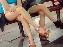 Two hot bunnies expose their long tasty legs in public