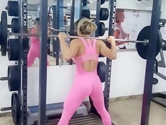 Stunning lass with a huge ass works out in the gym