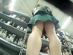 Delicious broad in a green skirt is not wearing any panties