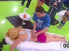 Athletic lady receives a massage live on the television