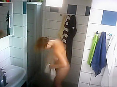 Woman with large boobs filmed when showering