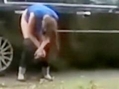 Desperate babe pees on a public suburban street