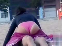 Horny drunken girl riding his pecker on the beach