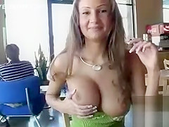 Pretty girl flashes her big tits in the restaurant