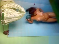 Young Latina gets clean in the bathtub