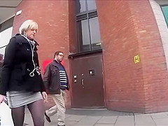 Boots and tights on a blonde on the street