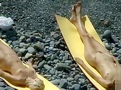 Two skinny young beauties tan nude