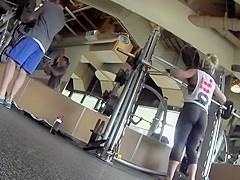 Weight lifting woman has a fantastic ass