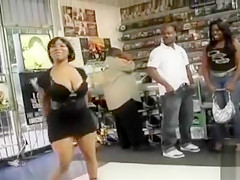Black dancer shakes her ghetto booty in the store