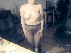 Large-breasted amateur coquette puts on her black pantyhose